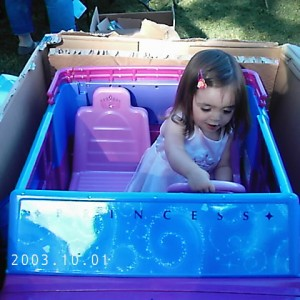 My neice in her Princess car!! aint she adorable